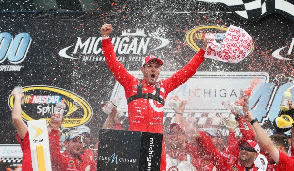 BROOKLYN, MI - AUGUST 28:  Kyle Larson, driver of the #42 Target Chevrolet, celebrates in victory lane after winning the NASCAR Sprint Cup Series Pure Michigan 400 at Michigan International Speedway on August 28, 2016 in Brooklyn, Michigan.  (Photo by Brian Lawdermilk/NASCAR via Getty Images)